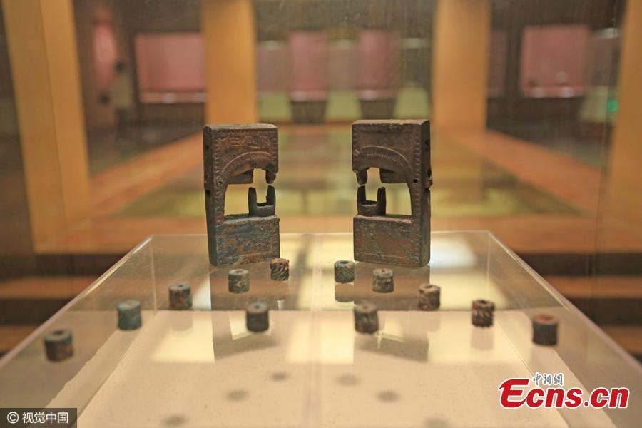 Bronze locks found in tomb symbolize eternal love