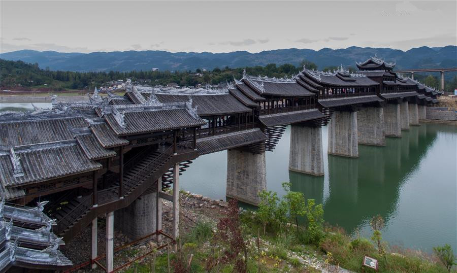 Tourists visit covered bridge in Chongqing