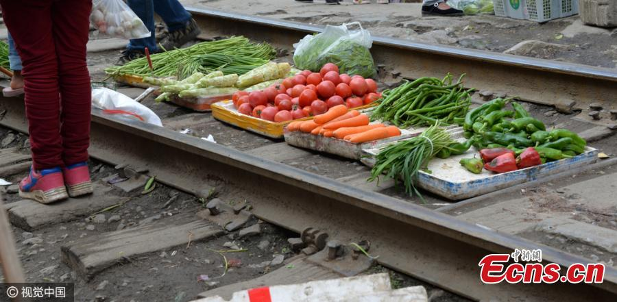 Vegetable market untroubled by trains