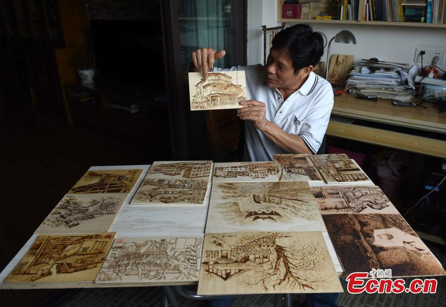 Man makes 5,000 pyrography works in Chongqing