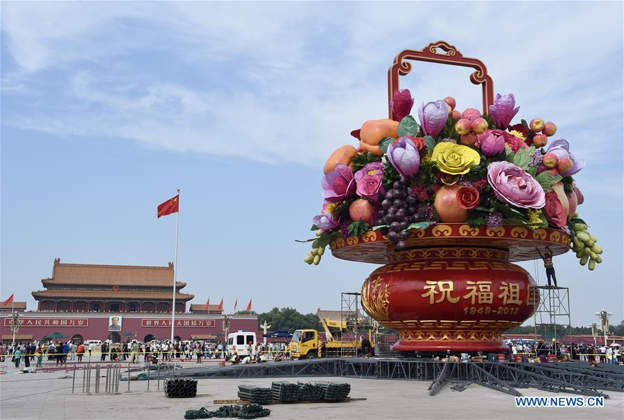 Workers set up large flower terrace on Tiananmen Square in Beijing