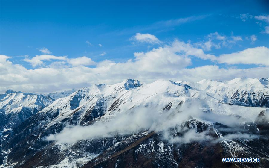 Aerial view of snow-covered Bayan Har Mountains in Qinghai
