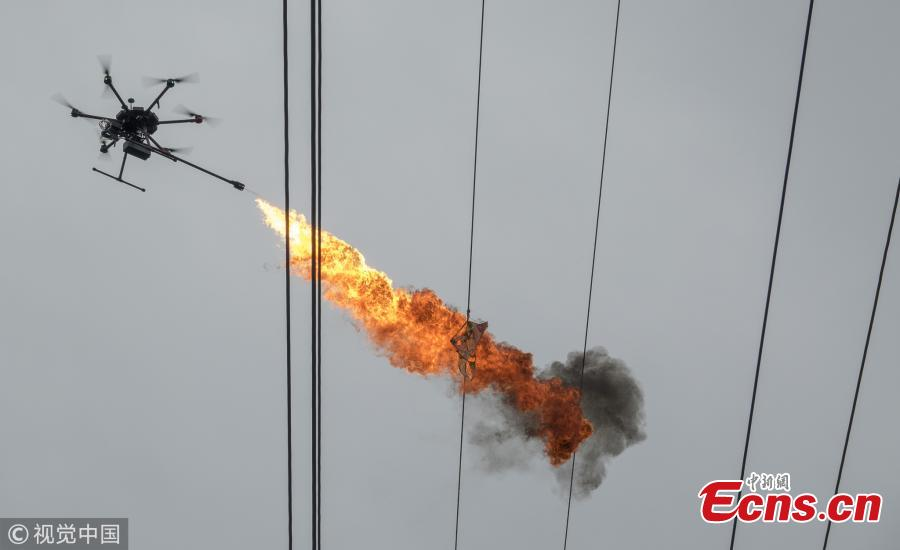 Drone spits fire to clear rubbish on high-tension power line