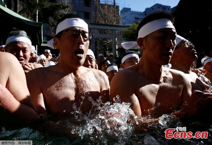 Hundreds seek good health in ice bath in Tokyo shrine