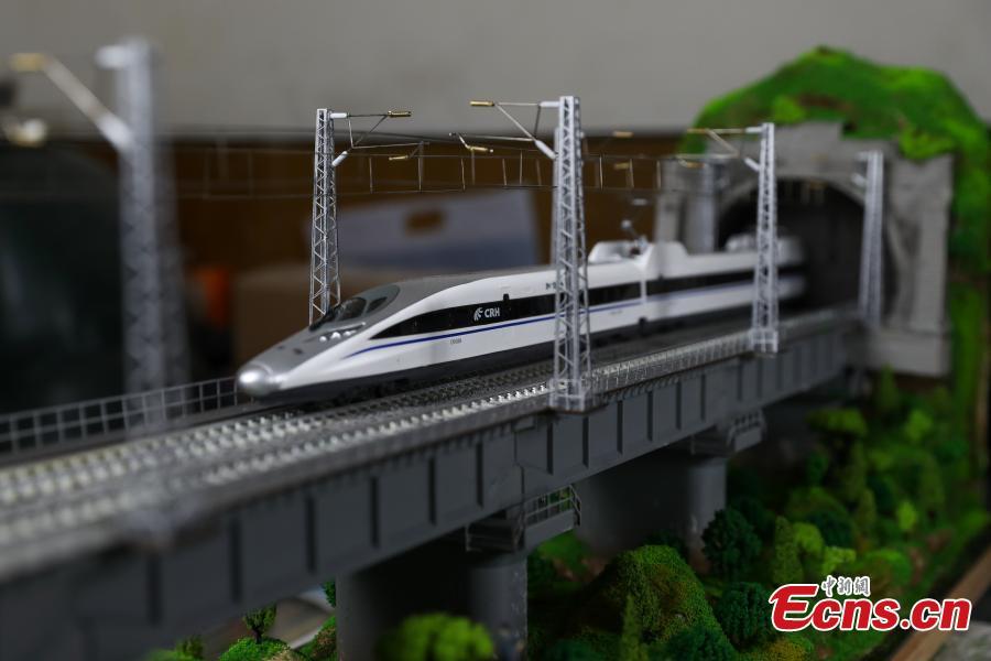 Train attendant makes replica to mark new high-speed railway