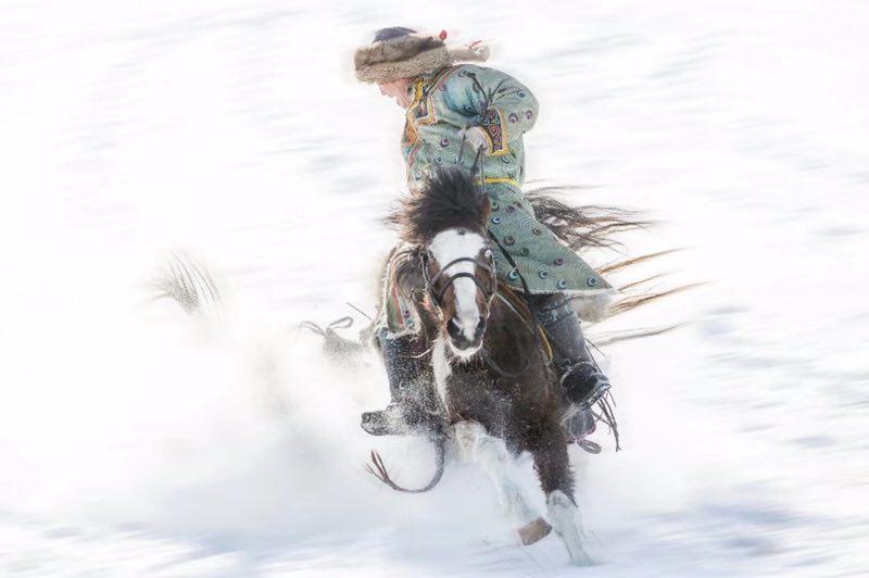 Women ride horses on Xilin Gol Grassland
