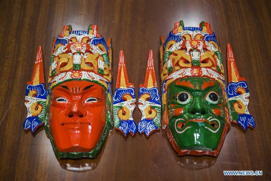 Wooden facial mask of local folk opera in Guizhou