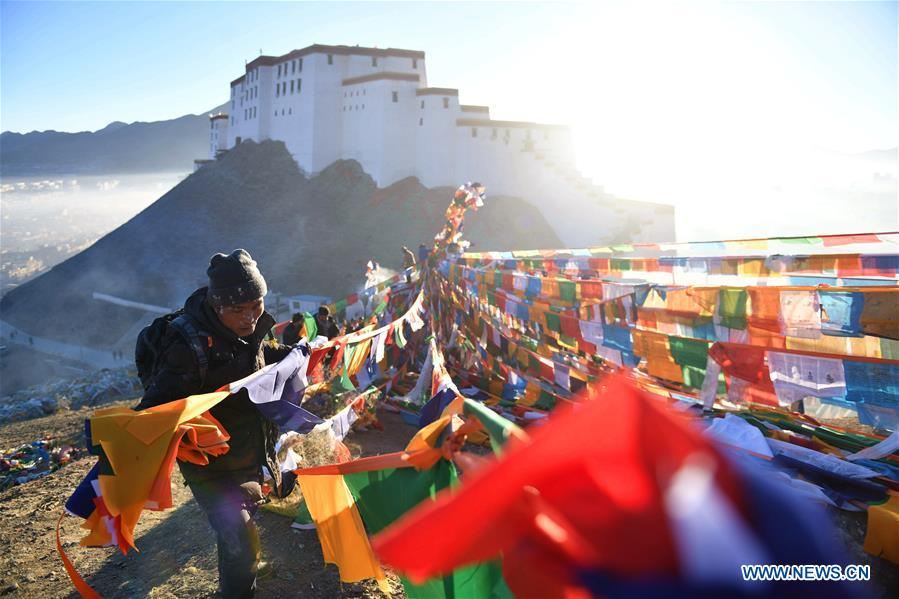 New prayer flags seen in China's Tibet to celebrate Tibetan New Year