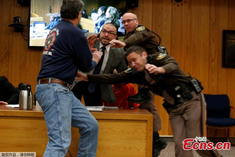 Victims' father tries to attack Larry Nassar in courtroom