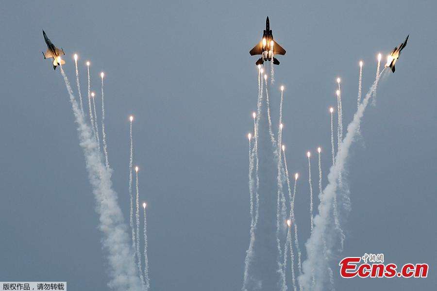Fighter jets rehearse for Singapore Airshow