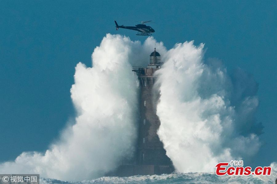 Incredible scene of helicopter flying close to a monster wave