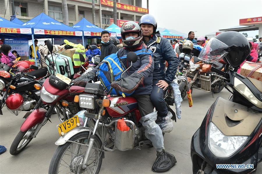 Migrant workers in south China go home by motorcycle during Spring Festival travel rush