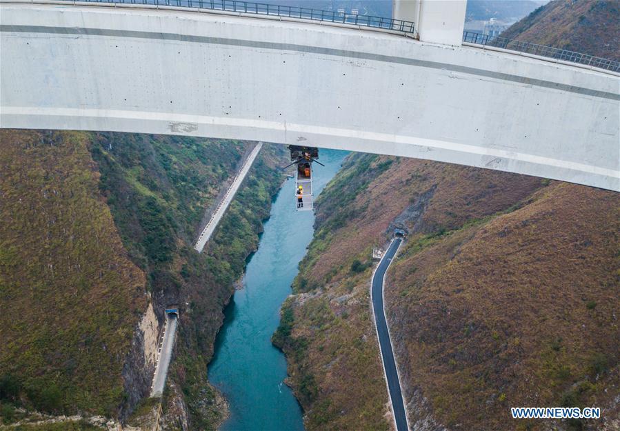 Workers examine railway bridge everyday for safety in Guizhou