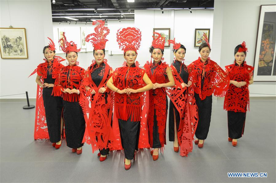 Paper cutting ornaments for qipao designed to greet Chinese lunar New Year