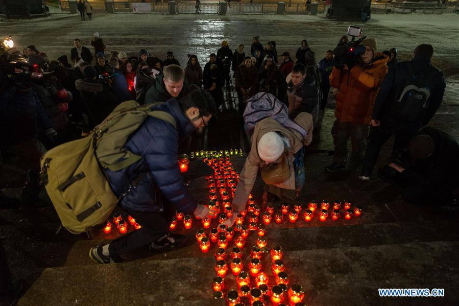 People mourn for victims after AN-148 jet crash