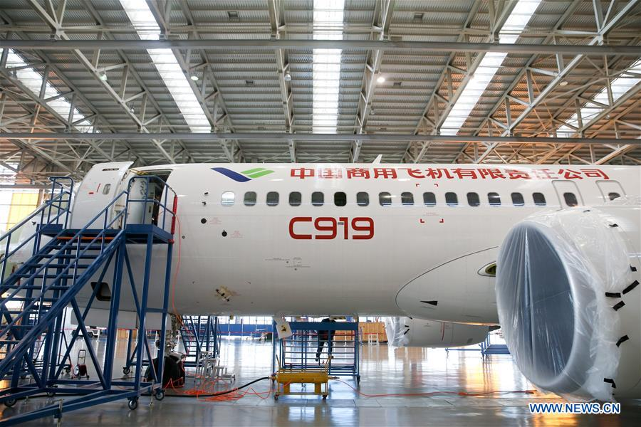 Staff members work on China's large passenger aircraft C919 in Shanghai