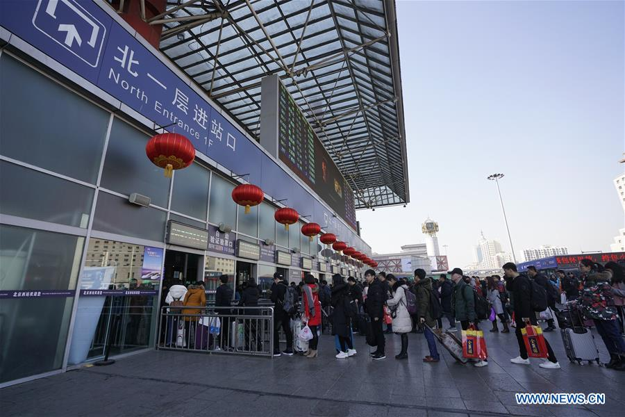Snapshots of passengers on way back home during Spring Festival travel rush