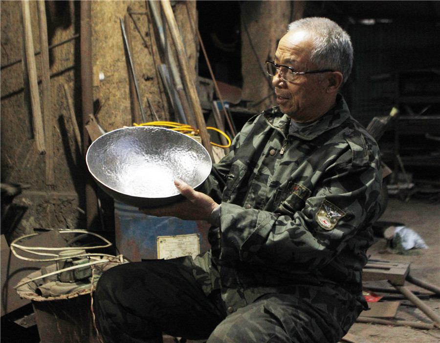 '<i>A Bite of China</i>' boosts sales of iron pans in E China