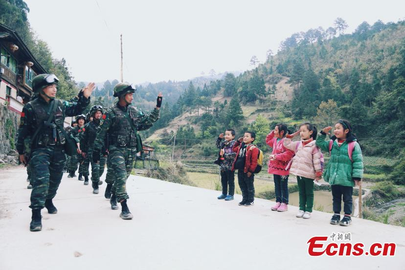 Children's salute to armed police