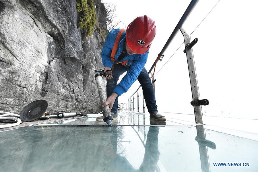 Workers replace glass pavement at Tianmenshan scenic area in Hunan