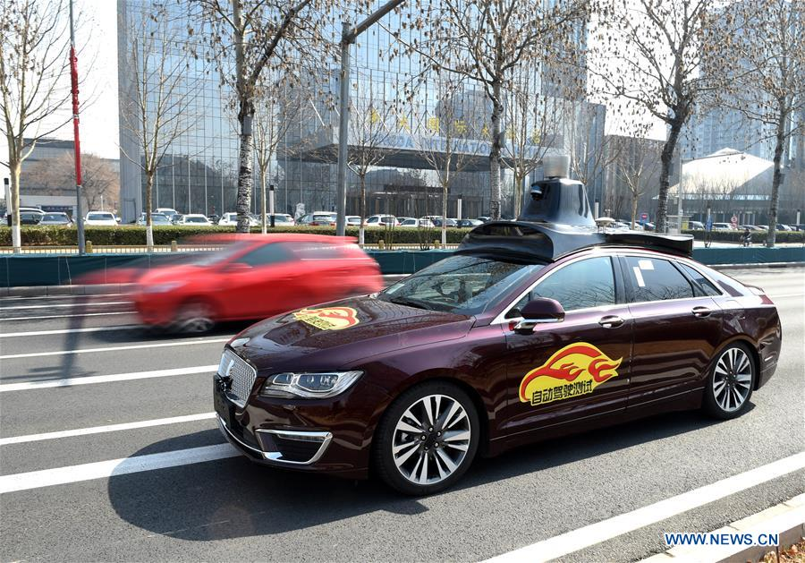 Beijing releases licenses for self-driving car road testing