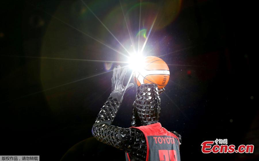 Toyota engineers unveil basketball playing robot