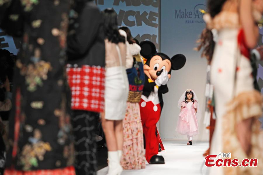 Mickey Mouse joins girl with leukemia in Shanghai fashion show