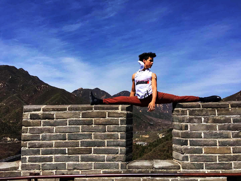 U.S. teenagers strike dance poses along the Great Wall