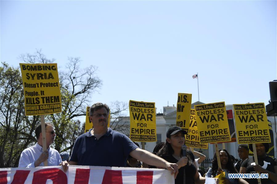 People protest against U.S. strike on Syria in Washington D.C.