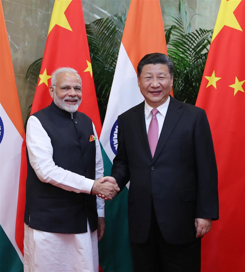 Xi meets Modi to discuss China-India ties