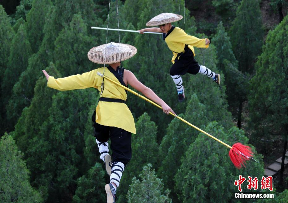 Kung Fu masters practice above Mt. Song in C China