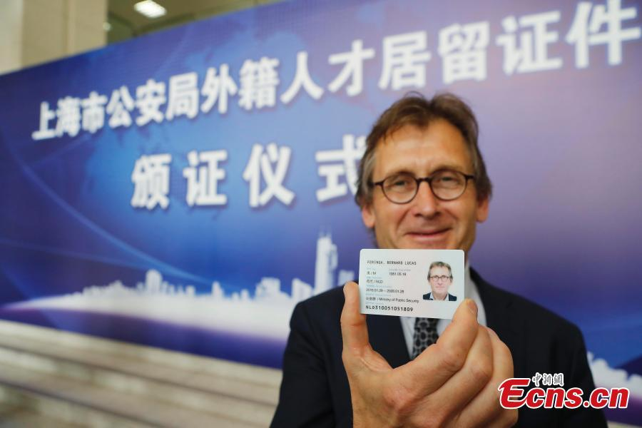 Shanghai issues green cards to seven foreigners