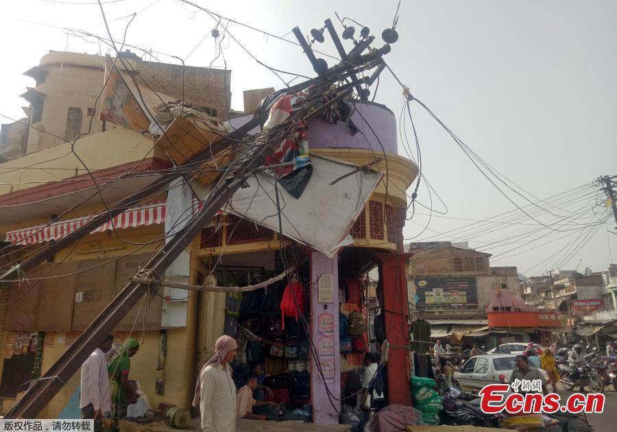 At least 125 killed as storms batter India