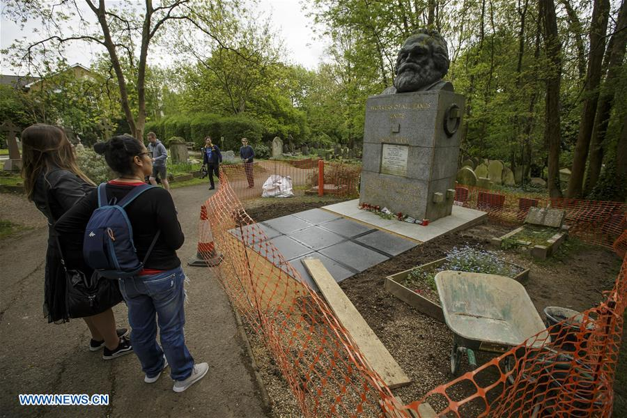People visit tomb of Karl Marx at Highgate Cemetery in London