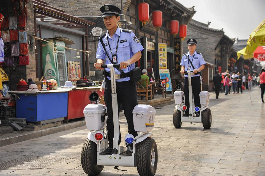 Police officers patrol with Segway-like self-balancing scooters in Shanxi