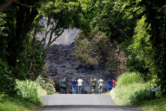 Wall of lava from Hawaii volcano threatens nearby villagers
