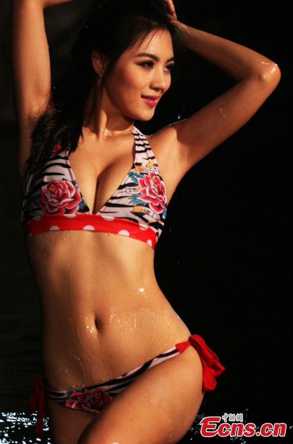 aef2ac7ecd2 A contestant pose for photo at the China finals of the 37th International  Miss Bikini Competition in Zhaoqing City, south China's Guangdong Province,  Jan.
