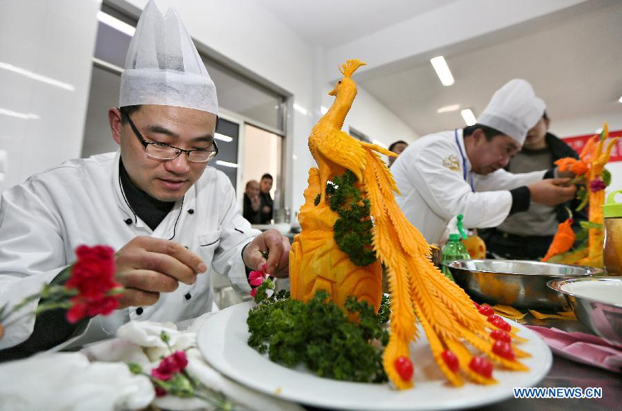 Fruit and vegetable carving contest held in e china 2 2 for Academy of oriental cuisine