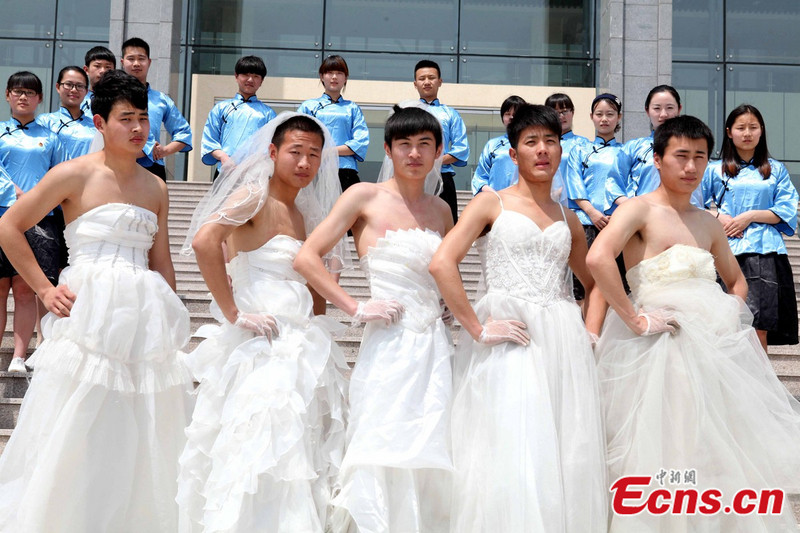 Wedding information men wearing bridal gowns