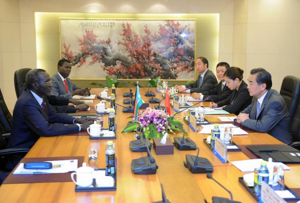Chinese Foreign Minister Wang Yi (1st R) meets with Stephen Dhieu Dau (1st L), special envoy of South Sudan's President Salva Kiir in Beijing, capital of China, July 11, 2013. (Xinhua/Zhang Duo)