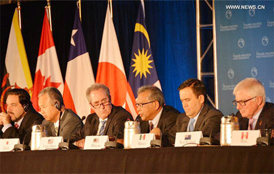 Trade ministers of the United States and 11 other Pacific Rim countries attend a press conference after negotiating the Trans-Pacific Partnership (TPP) trade agreement in Atlanta, the United States, on Oct. 5, 2015.