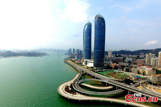 Yanwu Bridge and the landmark Twin Towers building in Xiamen City, Fujian Province. The 9th BRICS Summit will be held in Xiamen City in East China's Fujian Province in one month's time. (Photo: China News Service/Wang Dongming)