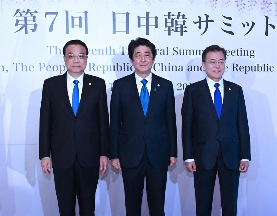 Abe's political fate and the trilateral summit