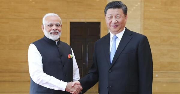 Xi meets Modi to discuss China-India ties