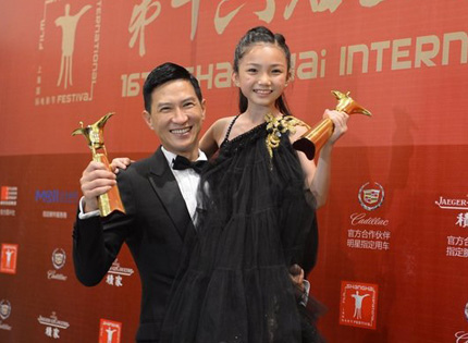 Hong Kong actor Nick Cheung celebrates winning the best actor award at the Shanghai International Film Festival for his portrayal of a broken man who was once a boxing champion in the Hong Kong film