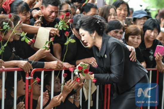 Supporters present flowers to Former Thai prime minister Yingluck Shinawatra upon her arrival at the Thai Supreme Court in Bangkok, Thailand, July 21, 2017. (Xinhua/Li Mangmang)