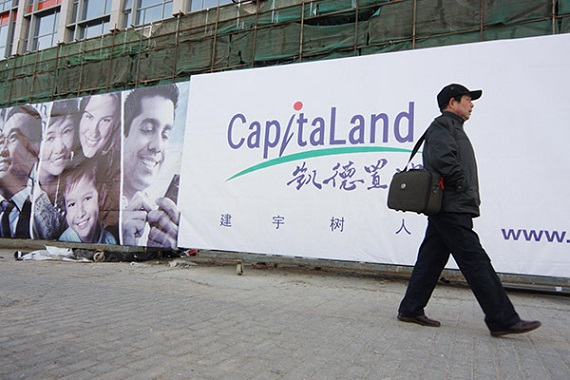 A man passes by CapitaLand Group's billboard in Beijing. The real estate company has sealed technology collaborations with leading Chinese players. (Photo by Nan Shan/for China Daily)
