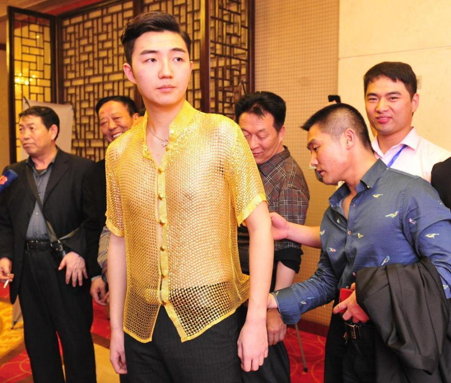A Male Model Shows Off Garment Made Of Three Kilograms Gold During An Event