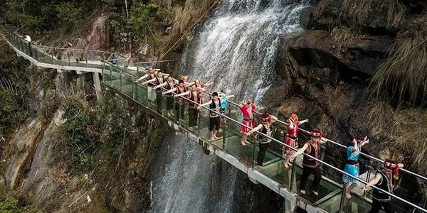 Would you dare try this glass walkway through waterfall?